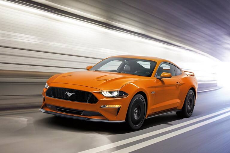 A 2021 Ford Mustang being driven through a tunnel