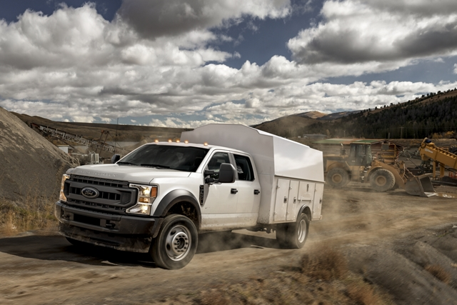 2020 Ford Super Duty F 4 50 Chassis Crew Cab in Oxford White driving uphill on a dirt mountain road