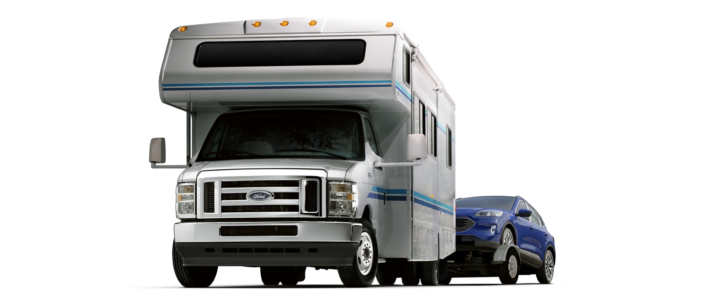 2022 Ford E Series Cutaway with Class C Motorhome towing a car on a trailer