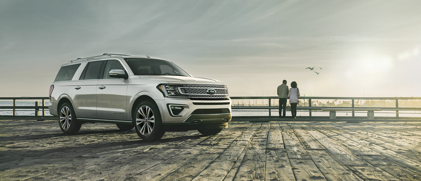 2021 Ford Expedition Platinum in Star White Metallic Tri coat on a dock by a lake