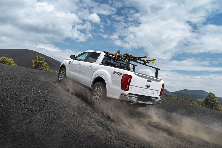 2021 Ford Ranger LARIAT F X 4 shown in Oxford White kicking up dust